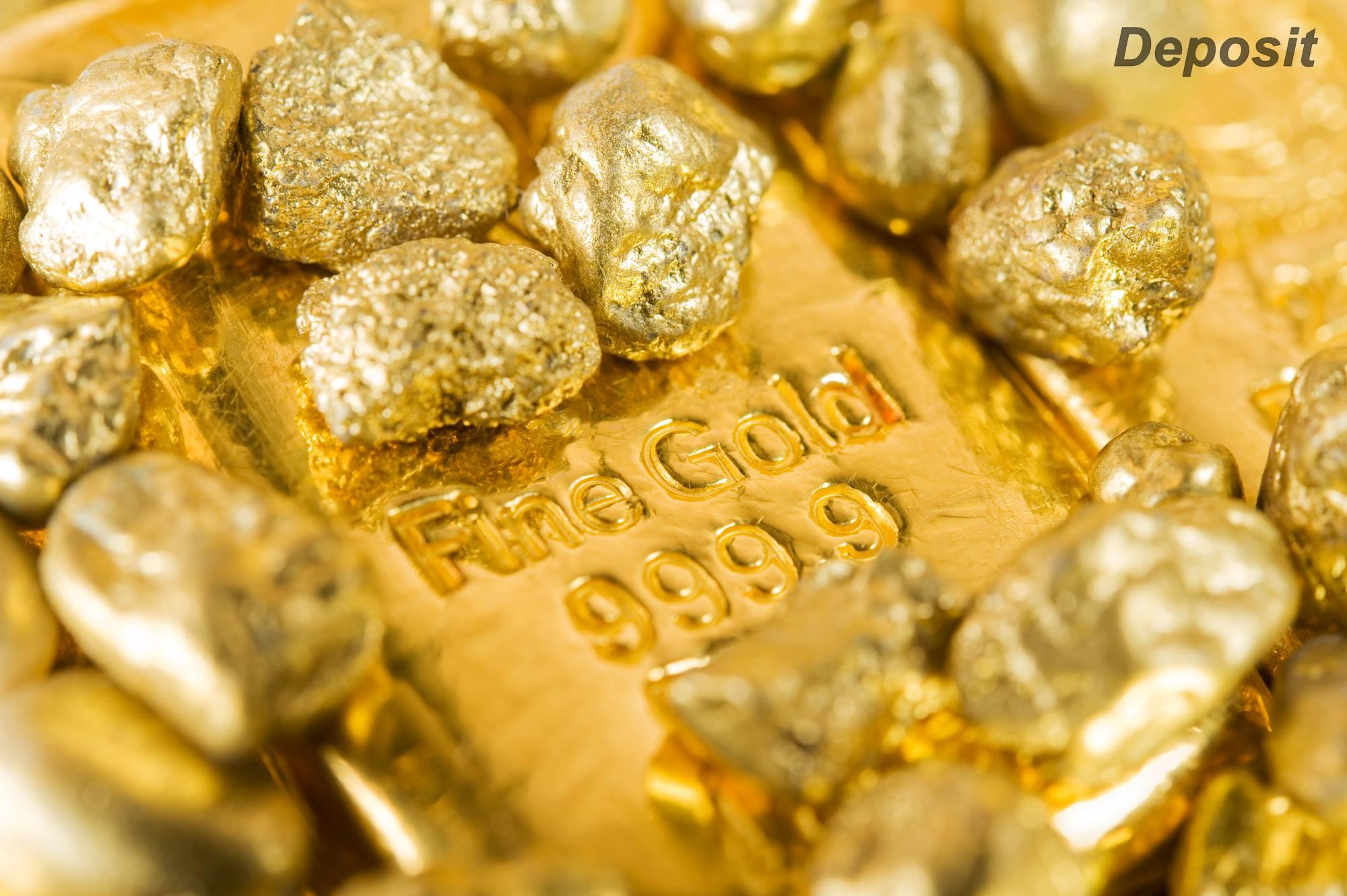 """גושי זהב ומטיל זהב. התמונה ממאגר """"דפוזיט"""" From """"Deposit"""" Photos"""