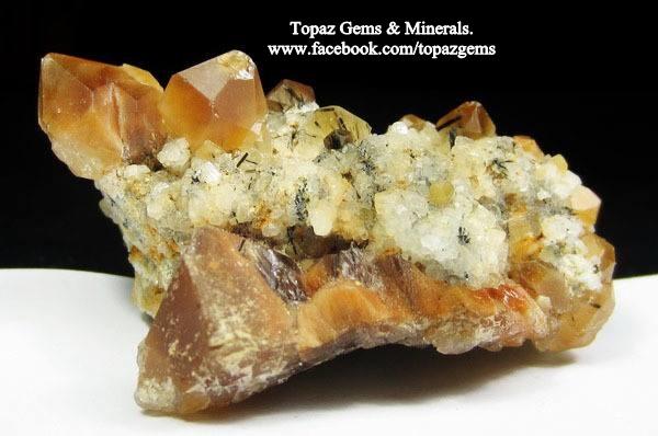 מושבה של גולדן הילר עם חוטי רוטיל. מהאוסף של טופז ג'מס מתאילנד. From the collection of Topaz Gems & Minerals