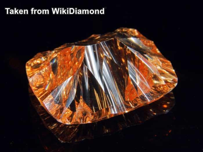 """אבן זירקון איכותית לתכשיט בצבע כתום-אש. מאתר """"ויקידיאמונד"""". Taken from WikiDiamond"""